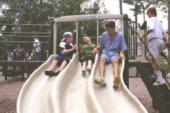 photo of children on a straight slide