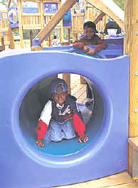 photo of children using a tunnel play space