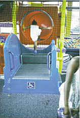 Photo of a transfer system at the entry of a soft contained play structure