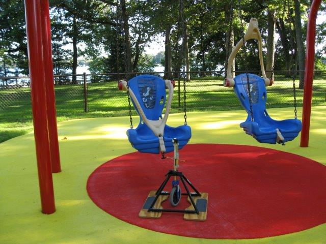 Two hard-back swings over a hybrid outdoor carpet surface system.