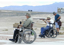 photo of persons using wheelchairs at shooting range