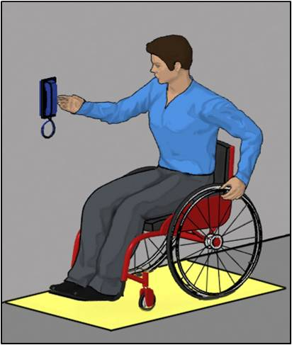 Person using wheelchair making side approach to wall-mounted phone