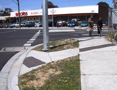 Figure 7. Australian use of bar tiles across sidewalk to indicate crossing location